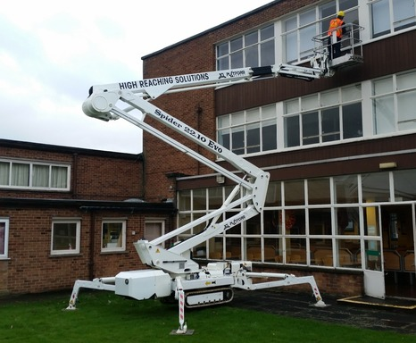 Selina tracked spiderlift set-up and reaching second floor for glazing repairs.